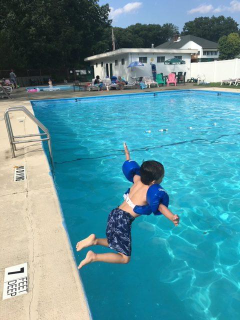 Twaalfskill Club Pool with Kid Jumping In